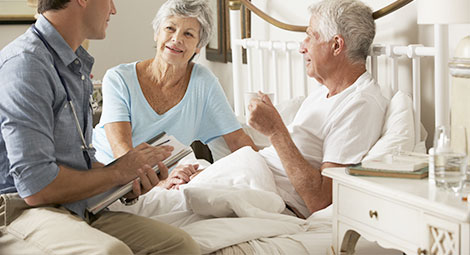 female nurse visiting patient at home